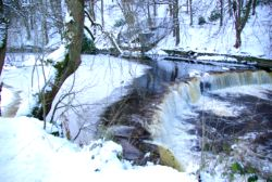 snow covered weir